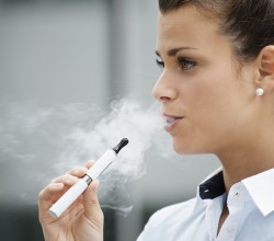 Woman smoking e-cigarette